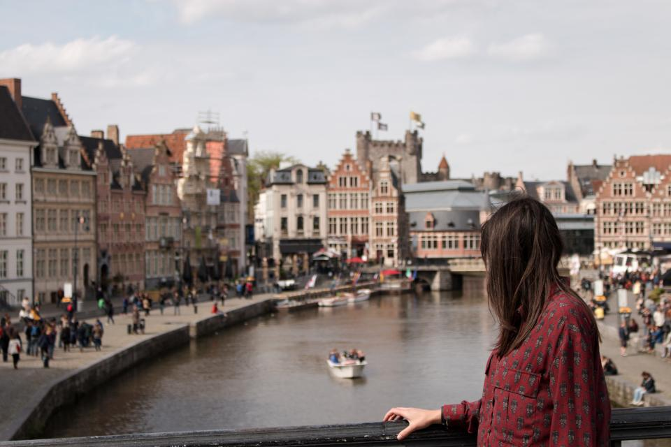 woman girl lady side view contemplate mesmerize architecture city canals waterways people europe
