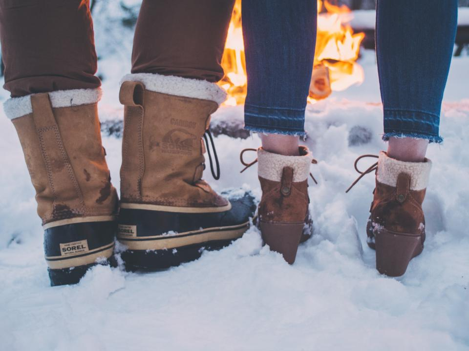 snow winter white cold weather ice nature people man woman couple boots