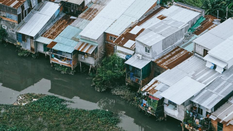 river water residential area houses grass rooftops