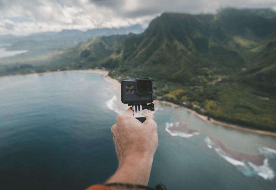 hand go pro camera selfie nature landscape mountain travel adventure water ocean sea beach waves current sand vacation