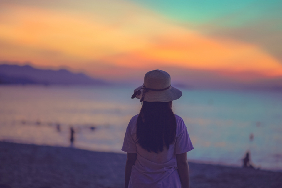 woman backlit beach clouds sky sunset evening landscape mountain nature ocean sea outdoors people soft