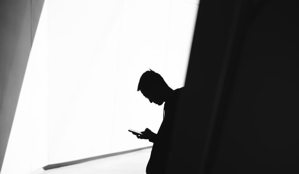 dark black and white people guy man texting communication silhouette