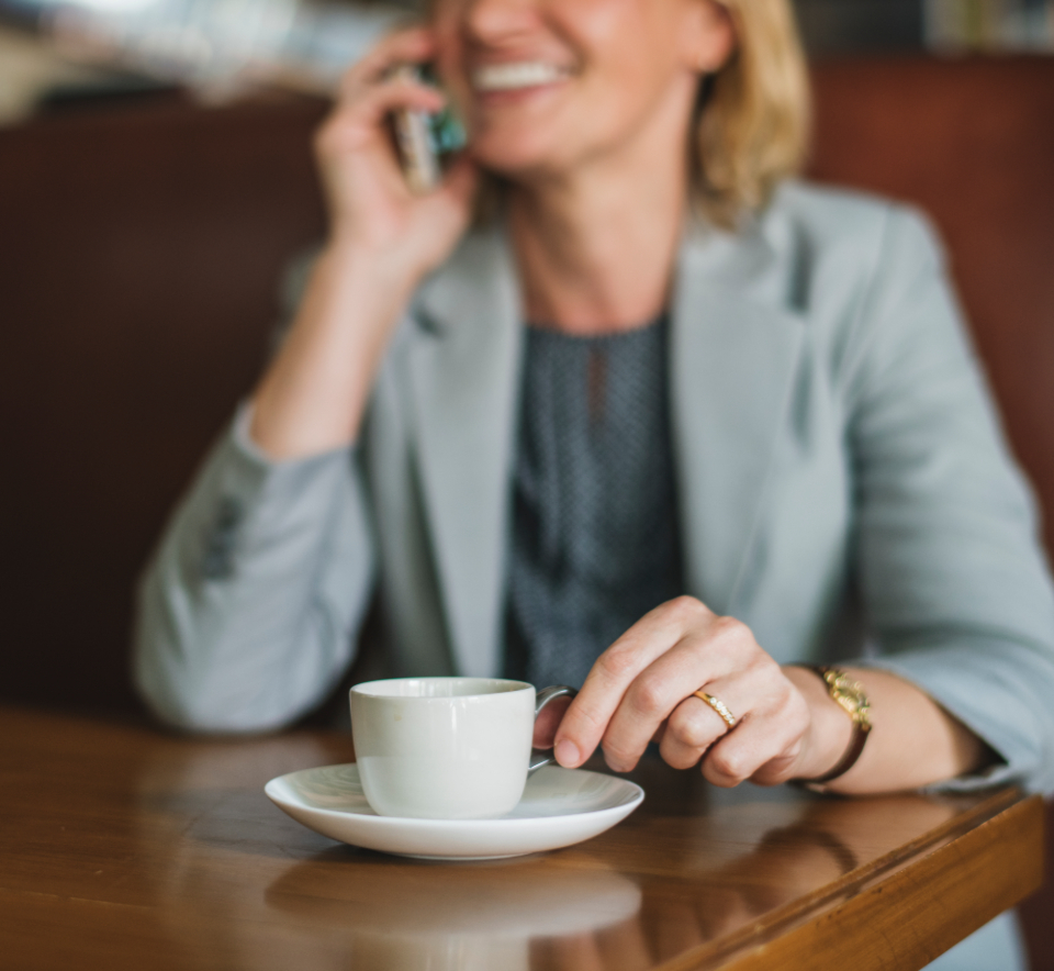 american beverage blazer blond business businesswoman cafe call calling casual caucasian ceo cheerful coffee coffee cup coffee shop communication connection cup digital device drink european female formal mobile phone mug