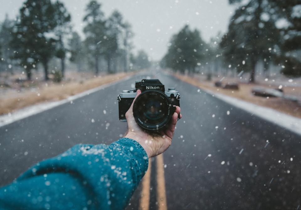 camera nikon lens black photography snow winter cold blur hand tree plant road travel