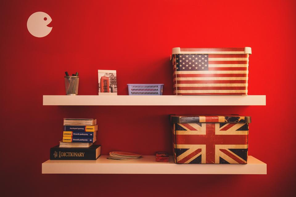 red wall interior design books knowledge flag box tray display organize art
