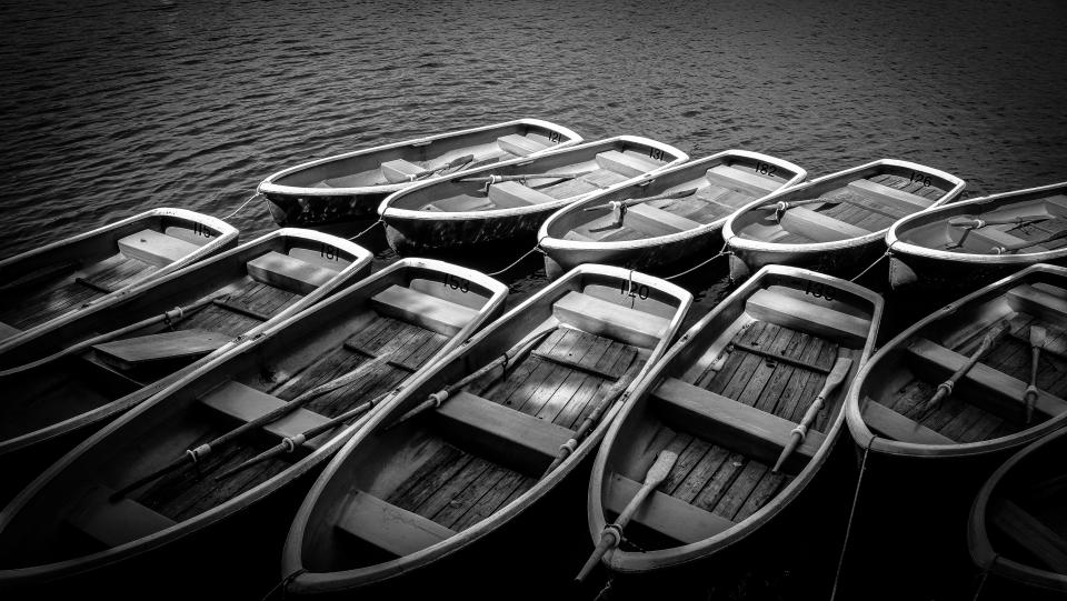 black and white monochrome boat paddle sailing water transportation sea ocean