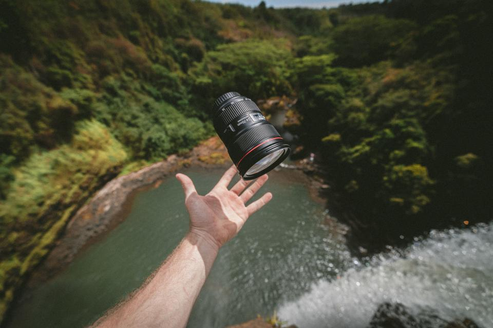 lens telephoto photographer photography travel adventure clouds sky mountain green river water
