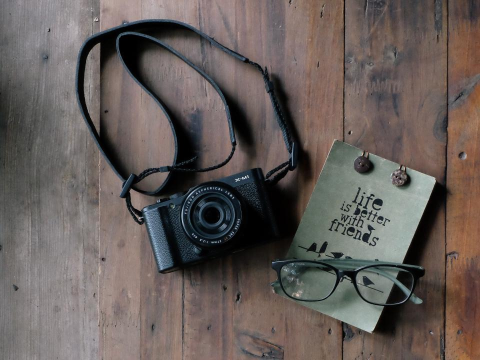 camera lens photography photo photographer old vintage fujifilm compact table wood office work eyeglasses frame lens book