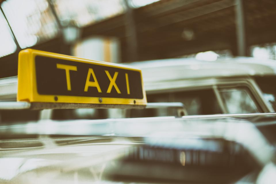 still items things taxi sign traffic cars vehicles city urban downtown  metro bokeh