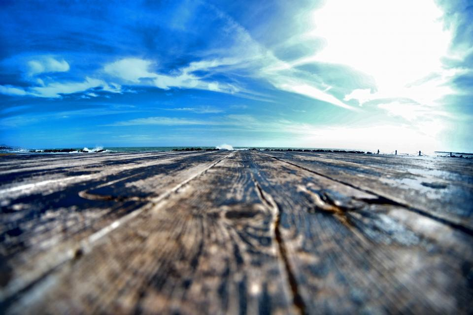 wood boardwalk clouds sky landscape outdoor view sunny daylight summer