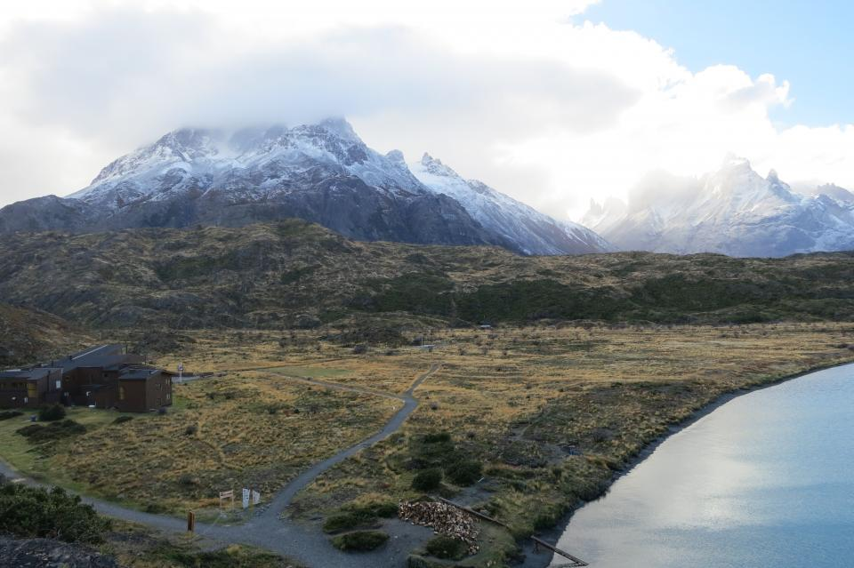 Torres Del Paine Patagonia Chile landscape mountains peaks snow sky clouds fields grass nature
