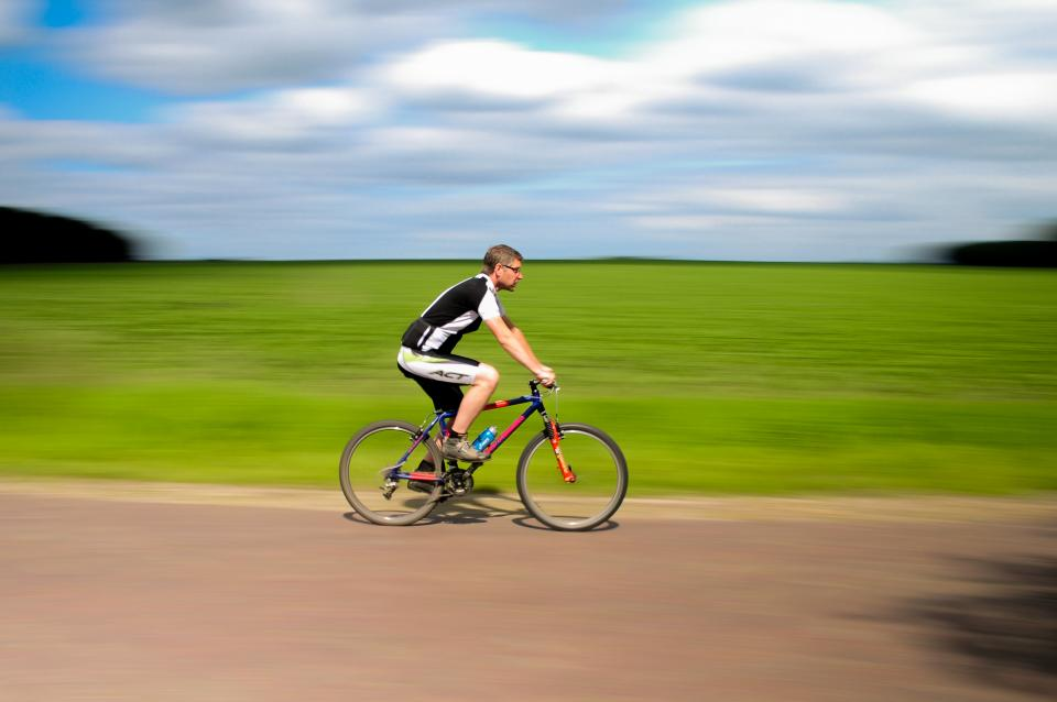 cyclist bike bicycle riding road exercise fitness
