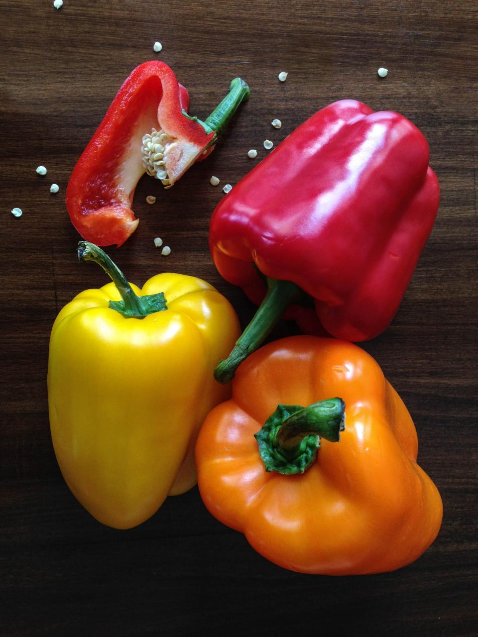 peppers vegetables red yellow orange seeds wood