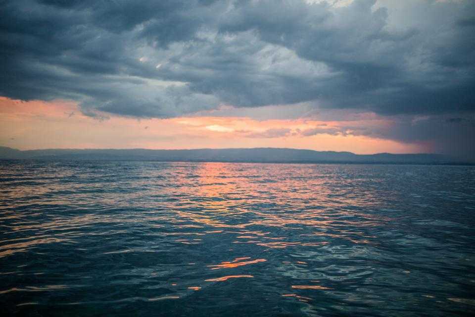 sunset dusk sky clouds cloudy storm grey ocean sea horizon water landscape