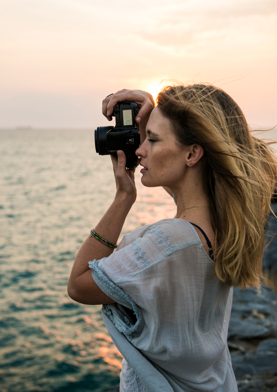 person joy holidays equipment ocean travel carefree digital coast wanderlust caucasian adventure girl traveling nature woman casual photographer trip water camera hobby journey concentrated sea tourism leisure enjoy