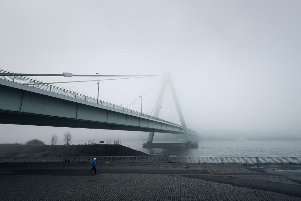 architecture bridge infrastructure fog cold weather road people man alone jogging exercise fitness health sea water