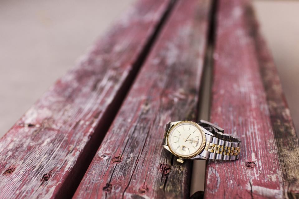 gold watch silver wood red bench