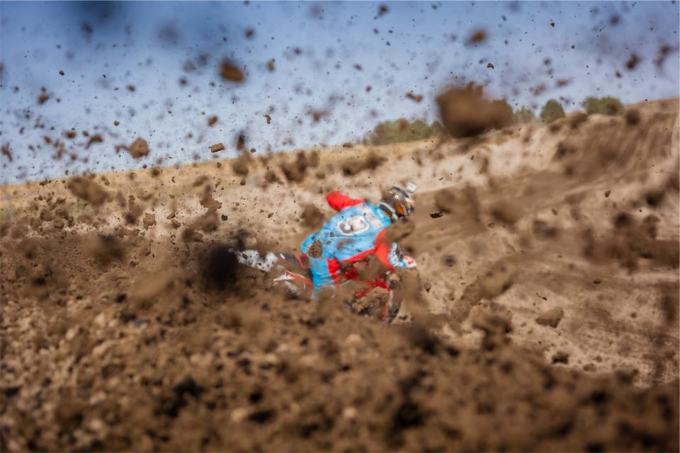 dirt bike racer racing mud track sports