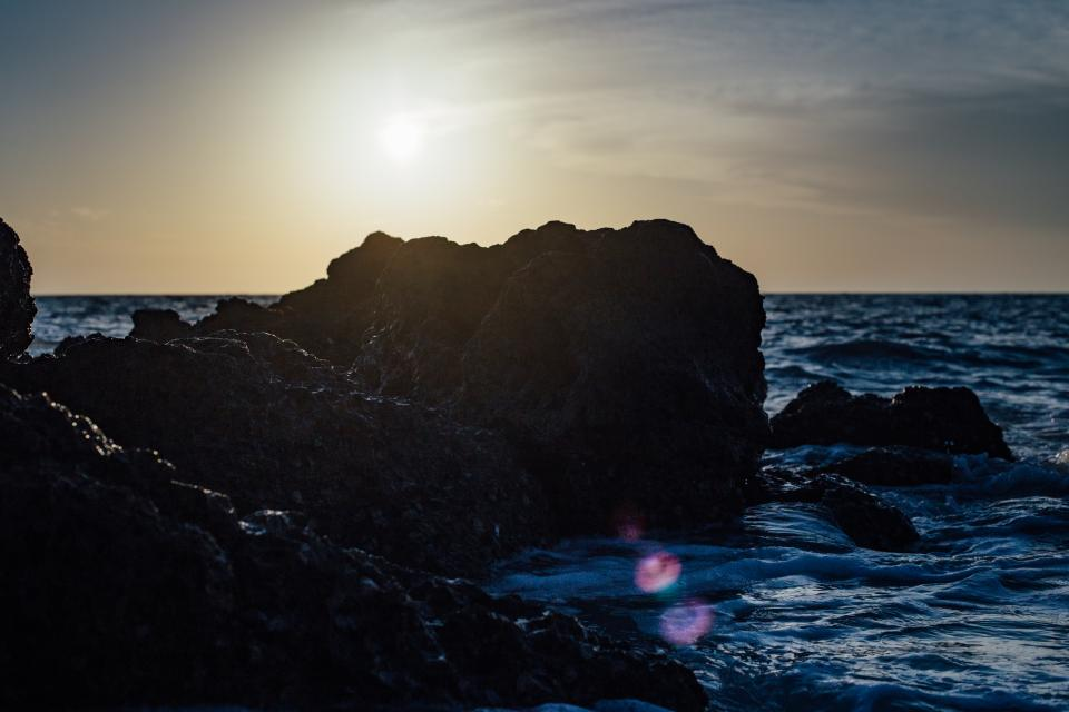 sea ocean water waves nature dark sunset rocks cliff