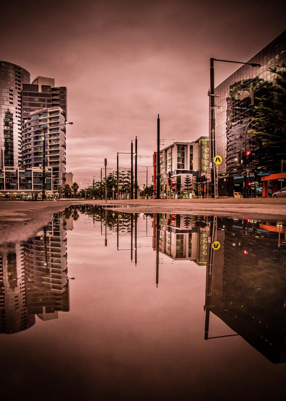 urban city reflection building establishment architecture clouds sky street road apartment office traffic light post