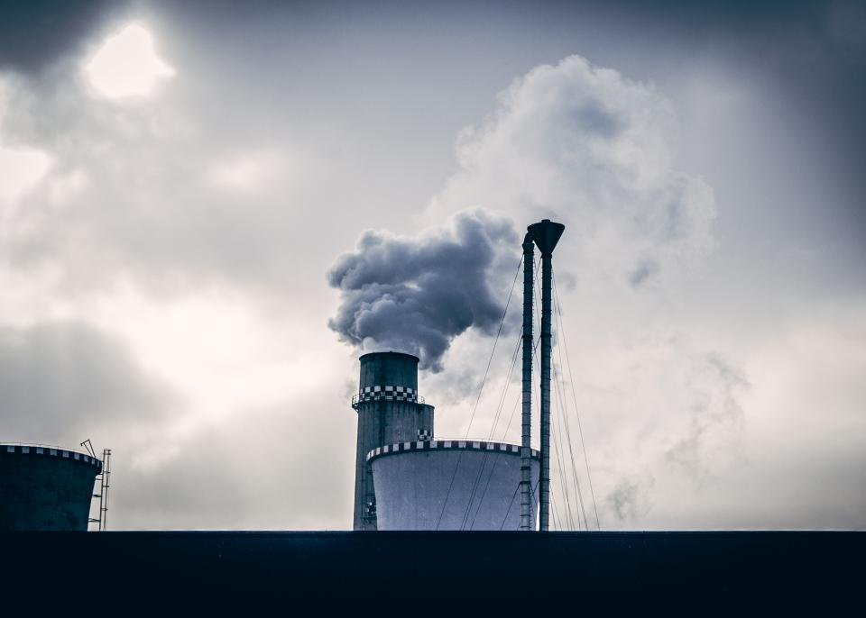 industrial factory smoke silos sky clouds cloudy