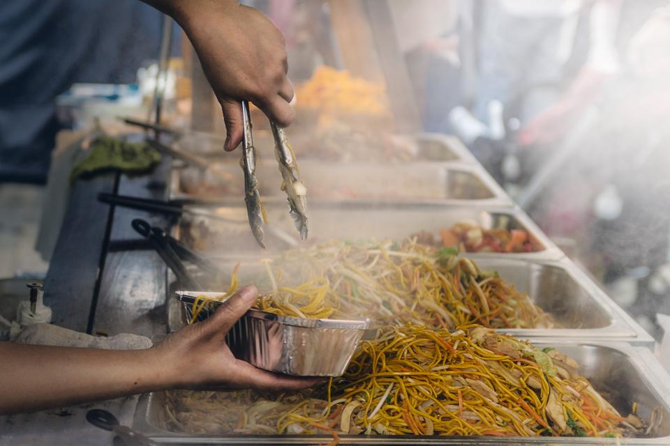 food buffet serving vendor market pasta hands smoke