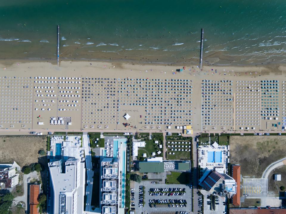 architecture buildings infrastructure aerial view beach sea water waves sand shore cottage plant
