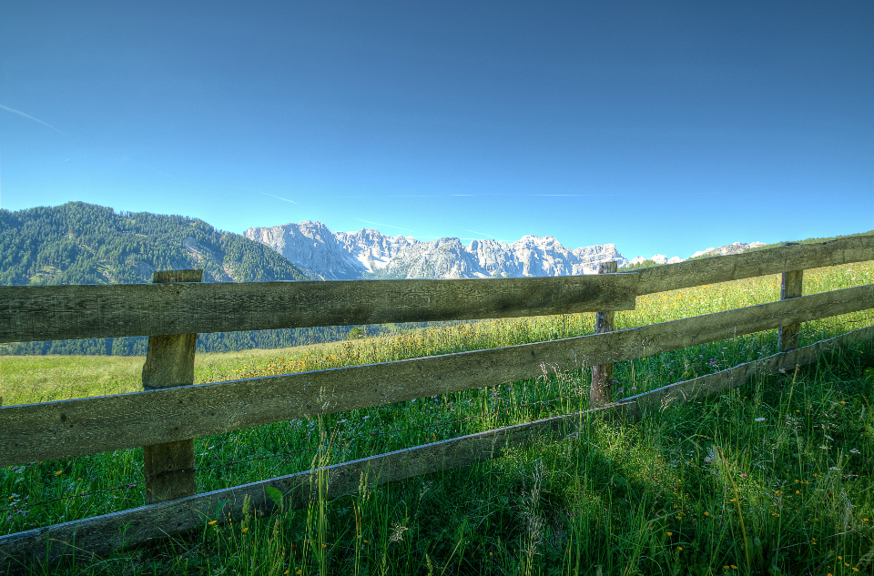 fence nature dolomites sky meadow field grass landscape blue sunshine summer hdr mountains outdoors