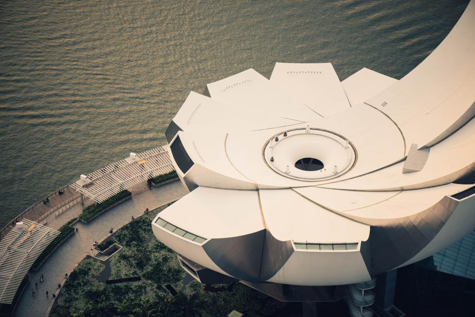 sea ocean water buildings aerial view city urban art science museum singapore landmark