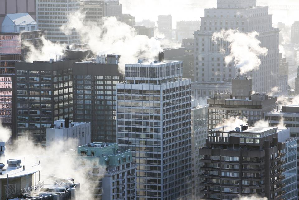 buildings architecture downtown city urban cityscape towers high rises rooftops smoke winter cold