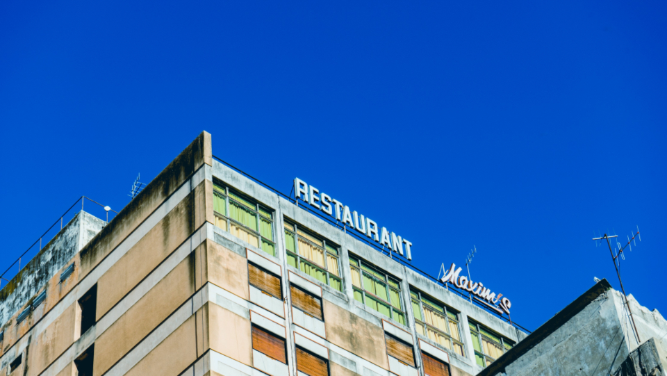 city building sign rooftop perspective signage restaurant urban architecture design sky view blue business