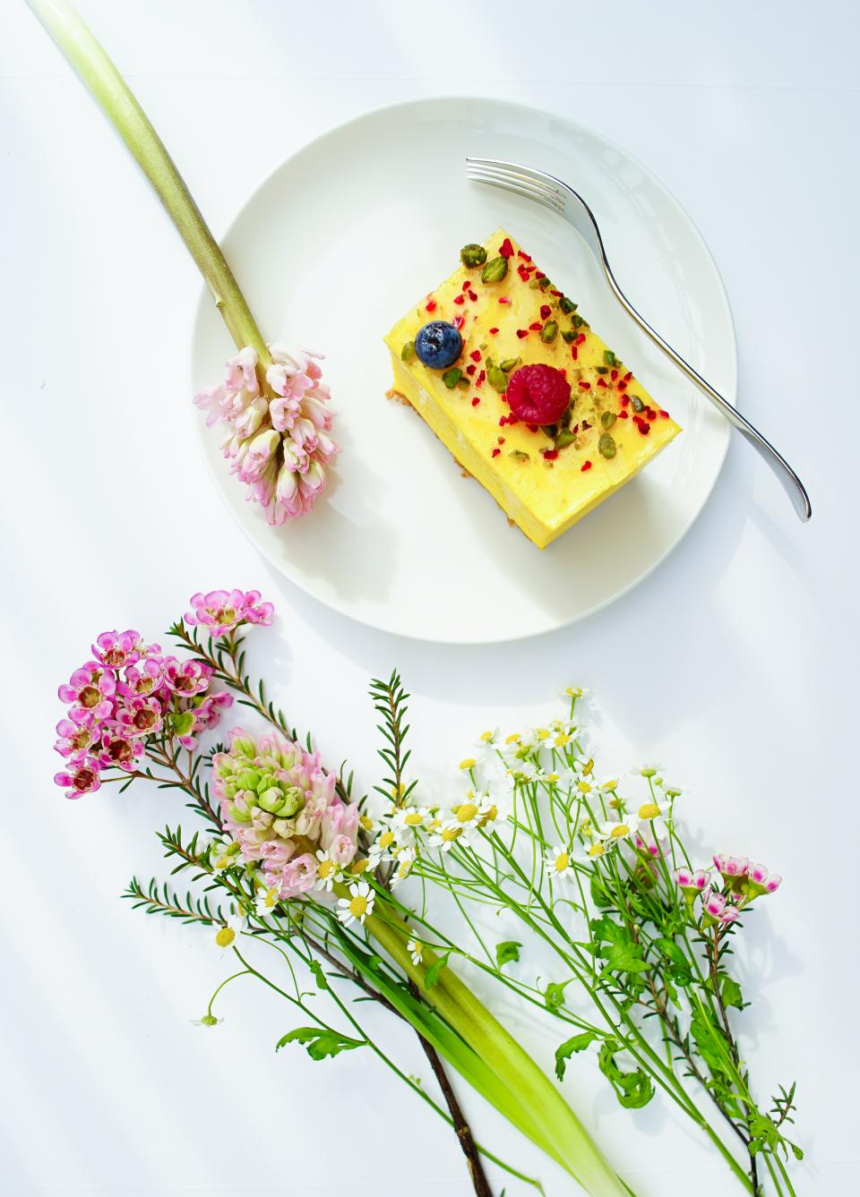 colorful flower plant nature display white plate fork food dessert sweets
