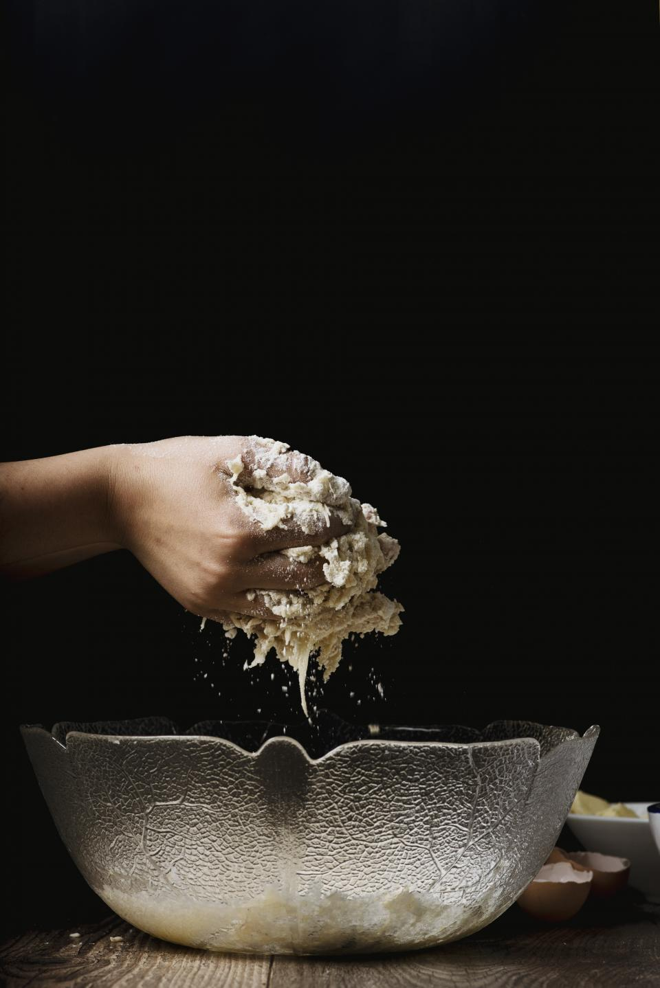 food cook mash knead dough batter glass bowl people person hands eggs bake pastry still bokeh