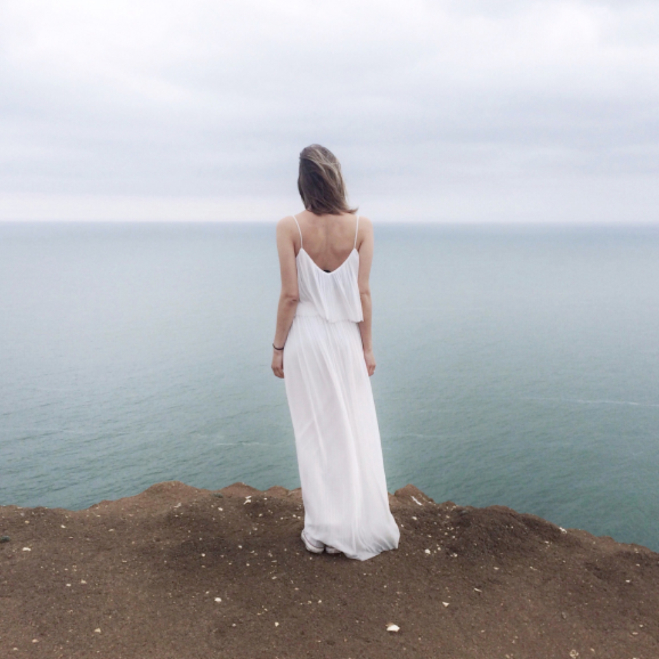 mystery woman cliff sea ocean fashion girl female pretty beautiful clouds think thought