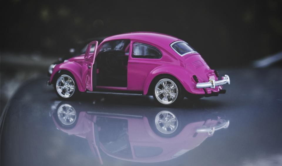 pink car small toy cab transportation vehicle play display reflection