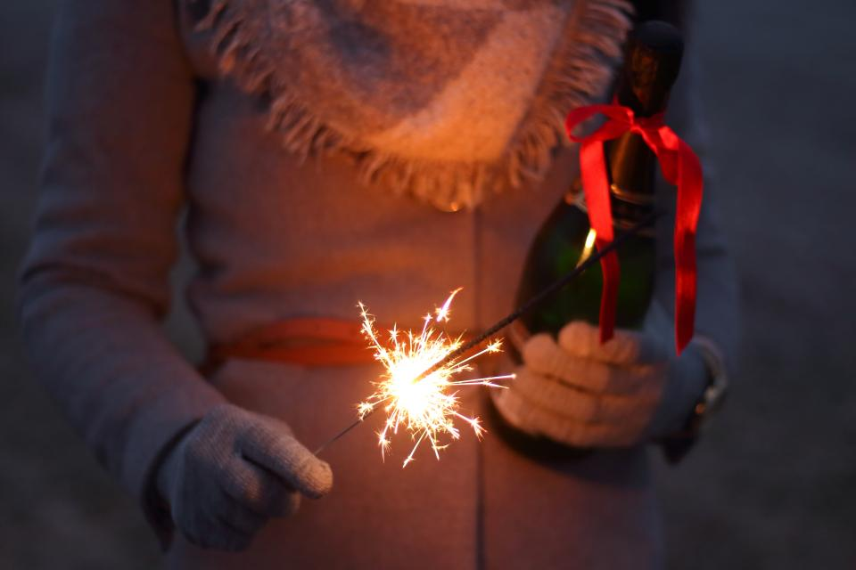 fireworks holiday celebration christmas dark night lights fire spark people woman ribbon gloves sweater scarf