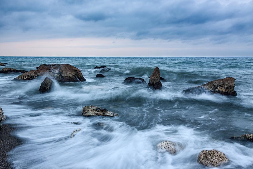 sea ocean water waves nature rocks horizon blue sky clouds