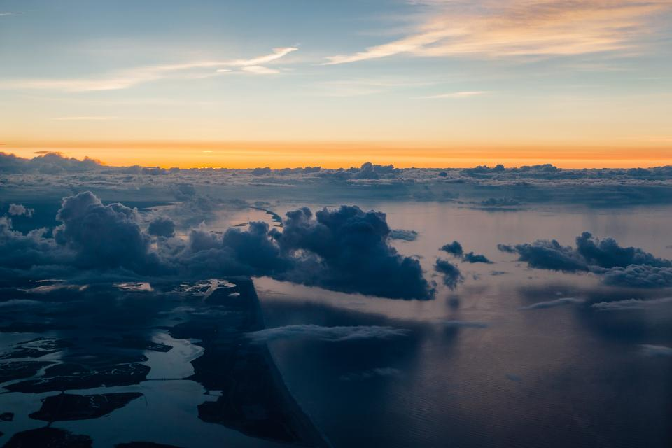 sky clouds sunset horizon travel aerial view flying ocean water
