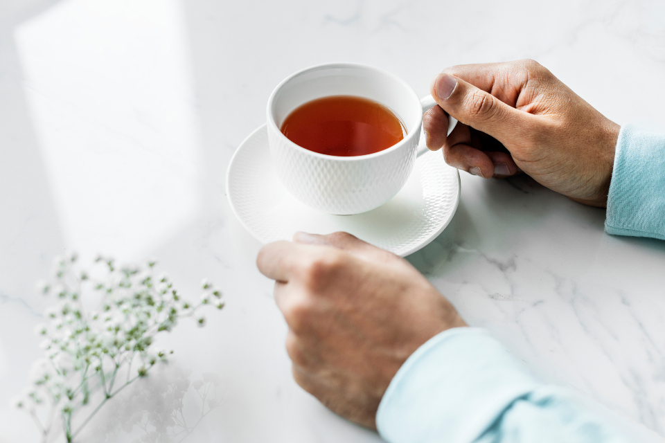 background beverage break clean closeup cozy cup daily drink drinking earl grey english tea enjoying flower free fresh hand holding hot drink lifestyle marble morning mug neat person refreshing relax routine simple table tea texture tim