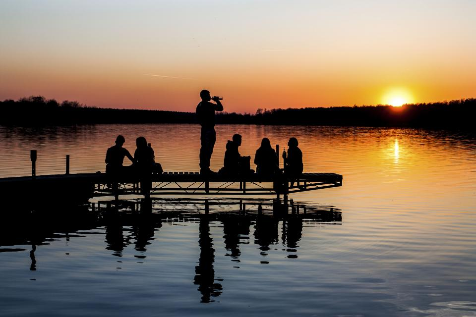 nature landscape sunset people bond hangout shadows silhouette water river lake dock trees travel adventure vacation