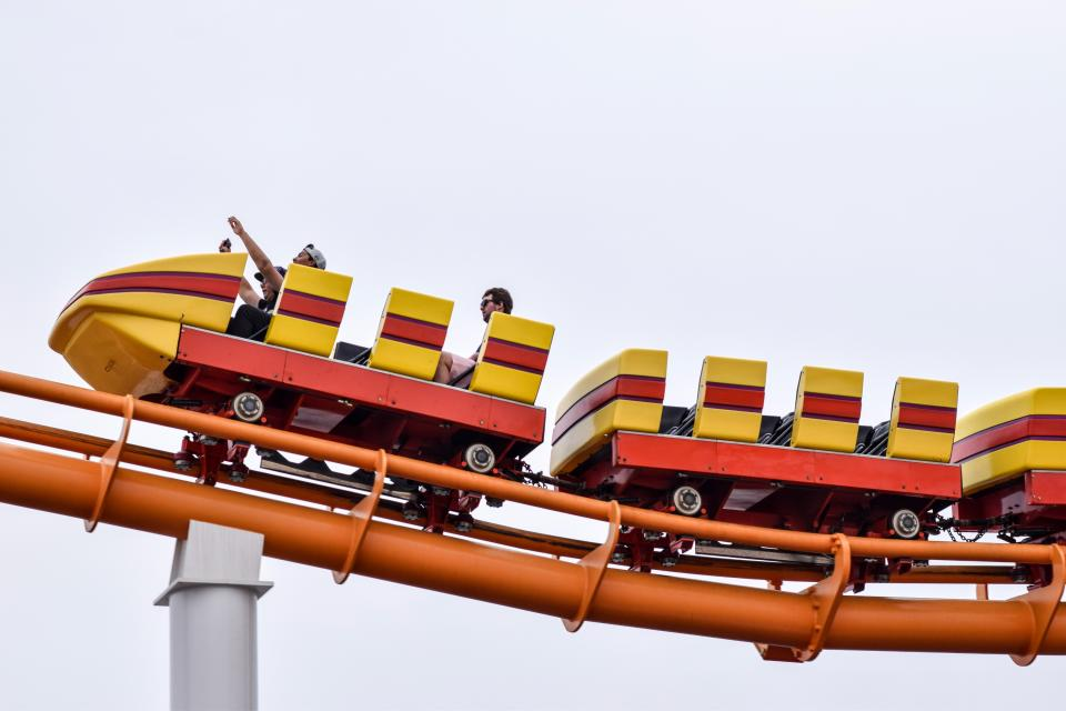 amusement ride adventure people roller coaster steel sky