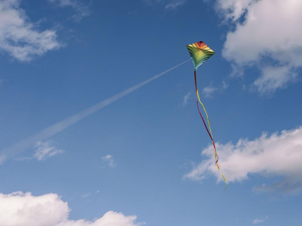 kite play blue sky clouds