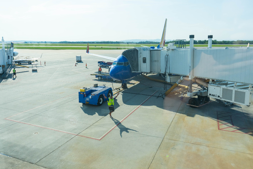 airport runway terminal airplane aircraft parked window view traffic baggage cargo boarding