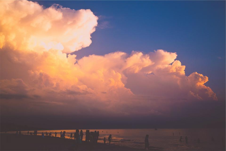 sunset clouds sky people beach sand ocean sea