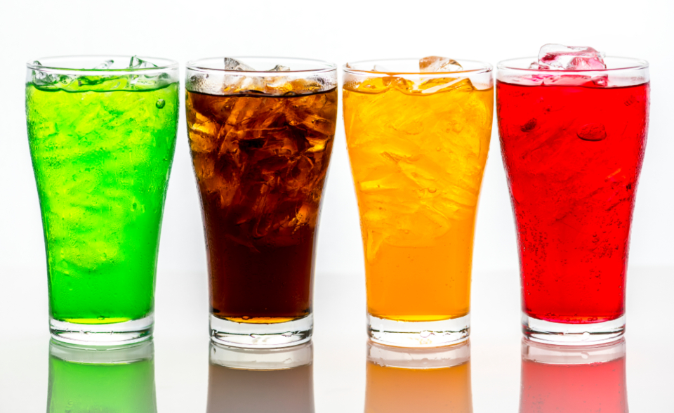 colorful soda drinks glass ice cups liquid beverage background mockup cold chilled thirsty party refreshment bubble close up cola fizzy flavored fresh pop