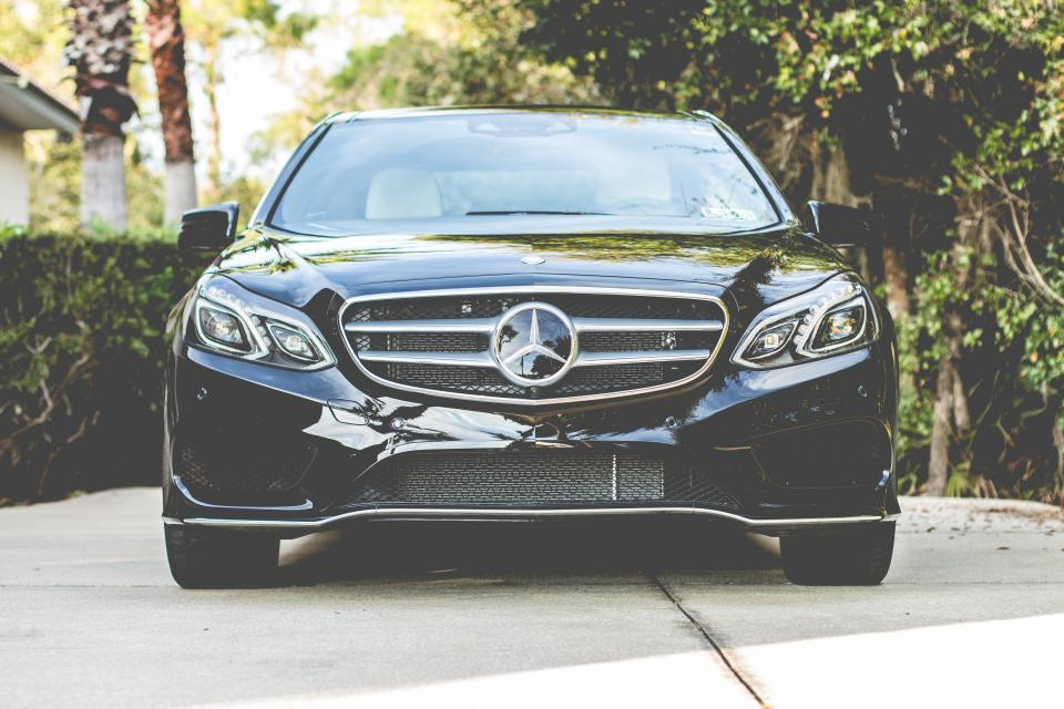 car vehicle headlights bumper black windshield trees park mercedez benz glossy shiny plants automotive reflection