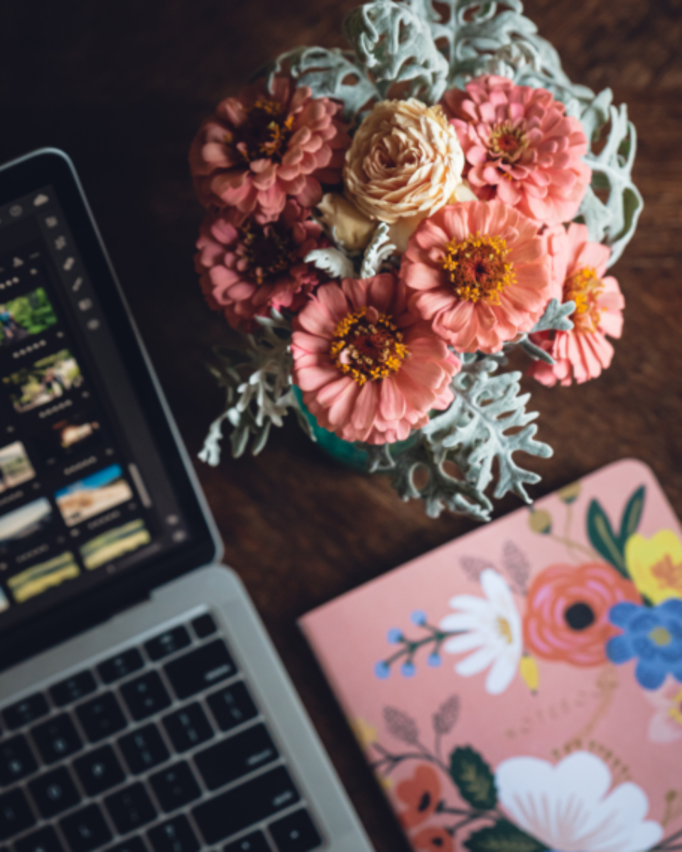 laptop desk flowers table bouquet fresh decoration notebook keyboard screen pretty arrangment workspace overhead flat lay device computer freelance