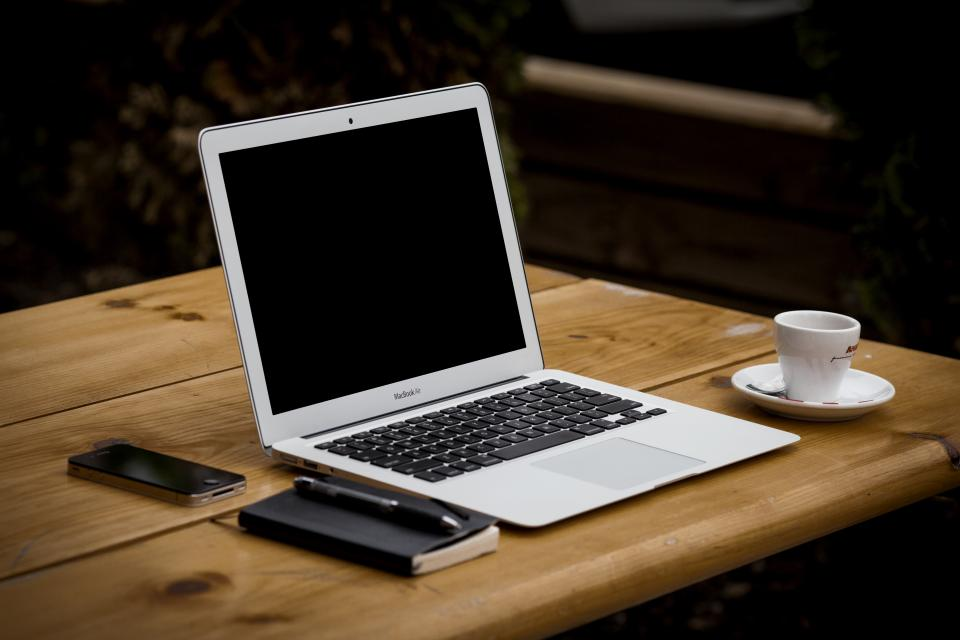 macbook air laptop computer notepad pen iphone table wood coffee espresso technology business apple