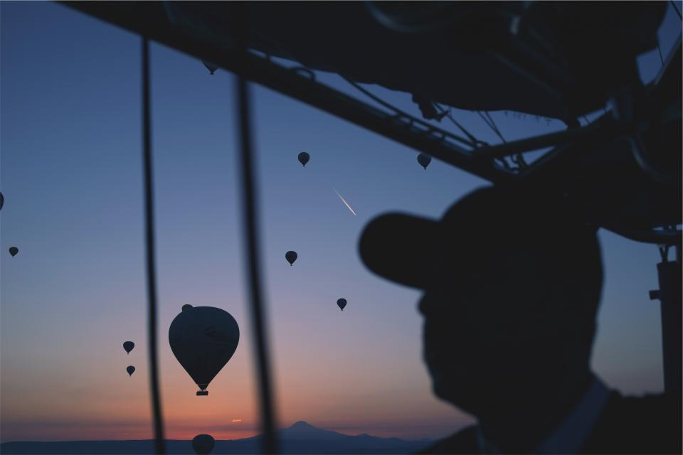 hot air balloons sunset dusk sky guy man hat silhouette shadows night evening