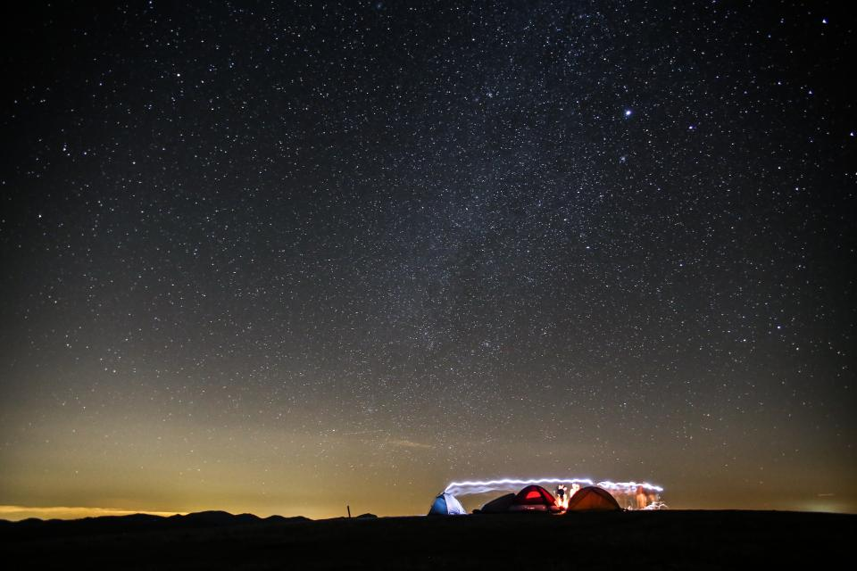 nature sky horizon night stars constellation camping tents light long exposure